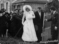 Eternal french pop star Johnny Hallyday and Silvie Vartan escape from the church by a side door after their wedding in 1965 in order to avoid the press.