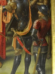 The man-at-arms on the right is a heavy armoured infantryman of the later 15th century. He wears a kettle hat, brigandine with small sleeves, haubergeon (short mail shirt) with a mail collar, full armour for the limbs, a short sword and a halberd or bill.