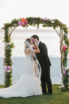 Not a shabby spot for your first kiss as a married couple | @erinmcginn | Brides.com