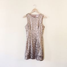 ⭐️⭐️HP | Gold sequin dress We're selling this for our cousin who only wore it once to a S16. It's in perfect condition, open back, and tight fitting  • 11326 • Esley Dresses
