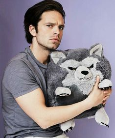 We all know who is cuter... (Hint it's not the fluffy wolf)