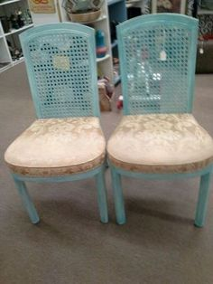 Used (normal wear) - We currently have a set of 2 matching came back chairs with upholstered seat, sold as a set.The chairs are a blend of creamy white and turquoise, the seats are a gold-tone fabric. In sturdy condition with no breaks in the cane. They can be seen in booth C 19 at Main Street Antique Mall 7260 East Main St ( E of Power Rd ) Mesa 85207  480 9241122open 7 days 10 till 530 Cash or charge accepted