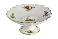 Royal Albert Old Country Roses 7-1/5-Inch Pedestal Bowl by Wedgwood. $38.24. Small pedestal bowl from the Royal Albert Old Country Roses dinnerware pattern; with a 7-1/5-inch diameter, pedestal dish adapts for serving petite bites or for simple display. Hand wash and avoid abrasive cleaning products; not safe for microwave use. Handpainted sprays of roses and their green foliage decorate the bowl's interior sides and center; smaller boughs adorn the exterior around the pede...