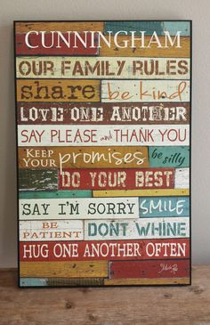Personalized family rules sign with family's last name laser engraved.