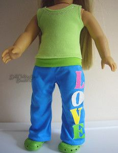 "Warm up style stretch pants with ""LOVE"" down the side of the leg, and a matching lime green ribbed tank top with bling around the neckline. On Ebay"