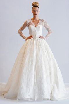 Designer Dennis Basso told us this lacy sleeved #wedding dress was inspired by Grace Kelly. Dennis Basso, Spring 2013