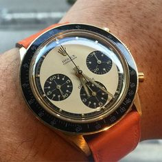 """""""A perfect example of stunning champagne Newman dial 14k gold 6241 matching with a shocking orange Hermes leather strap, belongs to my friend @iceman284912…"""""""