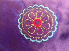 11th- and a small embroidery sample