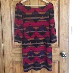 3/4 length light weight sweater dress Adorable shift style tribal print dress. V cut detail in back. Never been worn, but I foolishly took the tags off. Super cute with riding boots! Too tight on me these days. Everly Dresses Long Sleeve