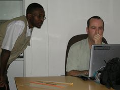 Dr. Godwin Orkeh, IMC, and Stephen Skakel of Bridge Foundation at IMC headquarters in Nyala, South Darfur discussing product distribution. 2008