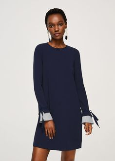 Flowy fabric Straight design Round neck Asymmetric button fastening at back