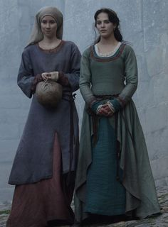 still from Kate Mosse's Labrinyth. Servant has most accurate clothes, of course. But I'm interested in  the lady's split skirt. Not period but works for mock-medieval story.