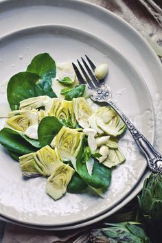Raw Artichoke Salad with Preserved Lemons, Green Almonds, and Parmesan