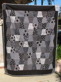 Black and white Accuquilt large tumbler quilt - super easy and backed with minky.