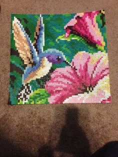 This is a hummingbird piece made out of perler beads. The design was inspired by my Aunts beautiful tattoo of a hummingbird. 13x13