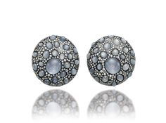 """JAR """"Shield"""" ear clips, 1991, of diamonds and cabochon star sapphires"""