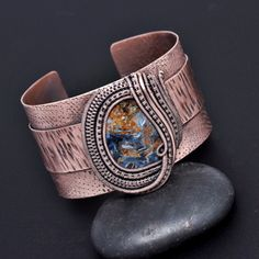 Wire wrap jewelry, copper jewelry, one of a kind jewelry and artisan creations, featuring gemstones and handmade art glass beads. Seed bead embroidery and hand woven copper and silver creations represent a harmonious relationship with a bohemian sense of fashion.