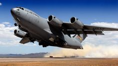 COOL SHOT OF BOEING C-17 GLOBEMASTER TAKING OFF FROM DIRT FIELD!