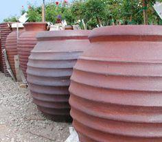 Love these terra cotta urns