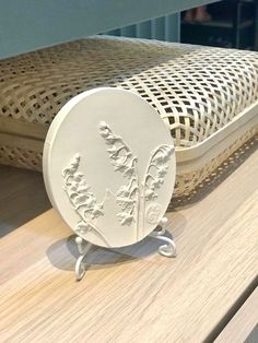 Lilies of the valley botanical bas-relief table and shelf decor by DinaArtDecor. Scandinavian oval wall decor as herbarium tile. Flowers art home decoration. Lilies of the valley oval botanical panel is ideal for decorating the entrance hall, living room, kitchen, bedroom or baby room