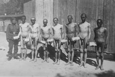 Naked Soviet POWs in a POW camp with a German guard.
