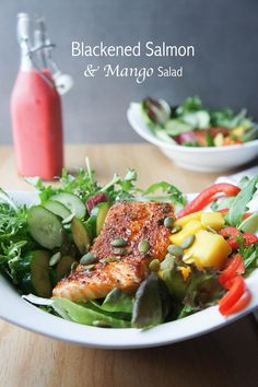 Blackened Salmon and Mango Salad -- served with a summery, raspberry vinaigrette. Perfect for summer nights!