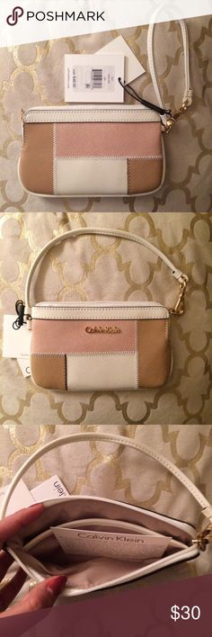 "NWT Calvin Klein leather wristlet patchwork ⚡️NWT Calvin Klein leather wristlet patchwork Pink White & Brown⚡️                                                                               ✖️brand new, with all original tags.              ✖️strap can be styled as wristlet or ""'mini purse""                                                    ✖️ships next day! Calvin Klein Bags Clutches & Wristlets"