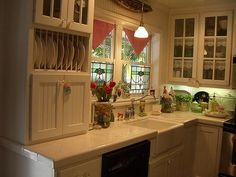 love it all, the lace in the cupboards , the gingham curtains, stained glass