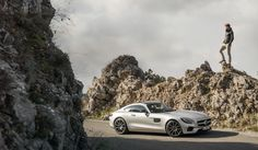 The driver takes some time to enjoy the view during his journey in the Mercedes-AMG GT straight through Europe.