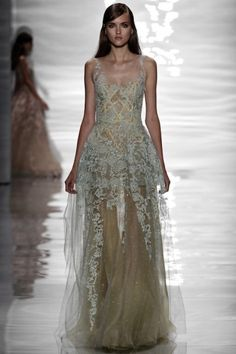 Vogue Wedding - wedding dresses on the catwalk. Click on the image to see more.