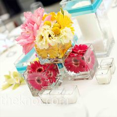 Modern Wedding Centerpieces. Different structure, but w/ right flowers I bet could be cute and memorable