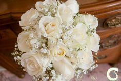 Ivory roses and gypsophila bridesmaid bouquet