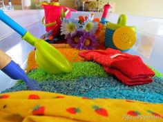 """Pretend Gardening For Tots  There's not a lot of gardening to be done on a rainy day, but start laying the groundwork by helping your tot make an indoor garden. Dye rice in different colors and create an """"indoor sandbox"""" of sorts for your kiddo to play with.  Source: Share & Remember"""