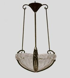 Hand forged iron ceiling fixture with glass panels by Genet et Michon.