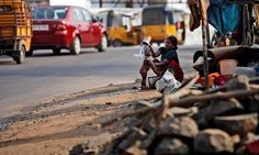 Hyderabad, India: A woman bathes her child at the side of a roadPhotograph: Mahesh Kumar A/AP