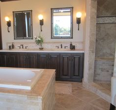 travertine bathroom - but white cabinets and nix the darkest tile in the shower