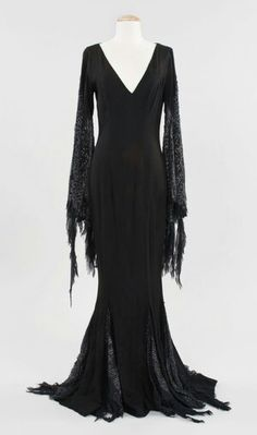 """Angelica Huston """"Morticia Addams"""" dress from Addams Family Values. (Paramount, A full-length form-fitting black gown with cobweb motif on the sleeves worn by Angelica Huston in the role of """"Morticia Addams"""" in Addams Family Values. Dark Fashion, Gothic Fashion, Steampunk Fashion, Emo Fashion, Morticia Addams Kostüm, Morticia Adams, The Dress, Fancy Dress, Addams Family Values"""