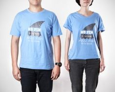 No Fin: Fin-Free T-Shirt in blue, made from 100% cotton. 3 Sizes: M L XL. For men and women. From www.moxyst.com
