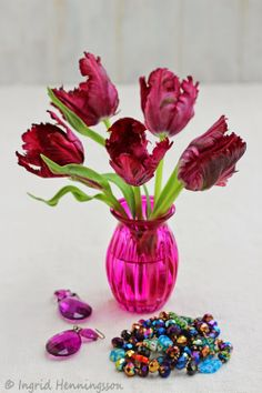 Tulips in Pink and Red Vases. Styling and photography © Ingrid Henningsson for Of Spring and Summer.