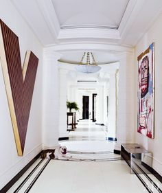 At this Manhattan apartment decorated by David Kleinberg, the homeowners' English bulldog, Bruce, greets guests in the limestone-paved gallery space, which includes works by Frank Stella (left) and Jean-Michel Basquiat Architectural Digest, New York City Apartment, Manhattan Apartment, City Apartments, White Rooms, White Walls, White Hallway, Floor Design, House Design