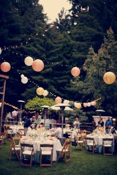Strings & bulbs with paper lanterns added randomly make this setting so inviting. @Brittany Galindo