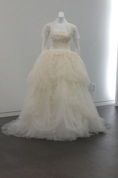 Love the laser cut lace and and lily of the valley details on this White by Vera Wang gown