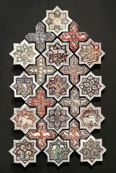 Stars and crosses coating, 13th century, Iran. Ceramic tiles with metallic lustre decoration. Louvre Museum, Paris.