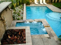 This stacked design by Scott Cohen incorporates all of the necessary elements for a great outdoor area: fire pit, hot tub and swimming pool. A raised stone wall provides privacy for a hot tub built for two.