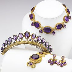 A killer amethyst parure, probably French. AMETHYST AND GOLD CANNETILLE PARURE. Pinkish yellow gold with green gold rosettes and details, the coronet in silver-gilt, circa 1840. Girondole earrings, coronet with comb, 14'' festoon necklace, 6 1/2'' bracelet. French marks for 18k, marked for Paris. 217 gs. GW. Via liveauctioneers.