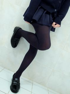 cardigan, pleated skirt, tights, and loafers.