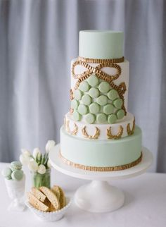 This Parisian-inspired mint green cake is definitely too pretty to eat, but we'd do it anyways! http://www.stylemepretty.com/2014/01/24/wedding-cake-ideas/  Photography: Katie Parra Photography Cake: The SweetSide #fashion #style #clothing