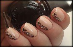 Nude polish with vertical filigree & rhinestone #nailart