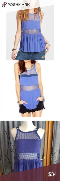 "NWT Free People xs snap out of it tank Dutch Blue NWT Free People xs snap out of it sheer panel tank in Dutch blue.  Details - Crew neck - Sleeveless - Woven straps - Sheer mesh panels - Ruffled peplum hem - Unlined - Approx. 27.5"" length Free People Tops"