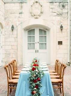 Lush garland and a dusty blue tablecloth: http://www.stylemepretty.com/little-black-book-blog/2015/02/06/romantic-cranberry-dusty-blue-wedding-inspiration/ | Photography: Mint - http://mymintphotography.com/